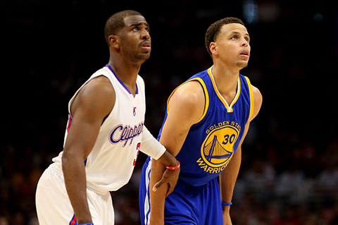 Chris Paul & Stephen Curry. (Photo by Stephen Dunn/Getty Images)